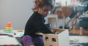 Toddler playing with wooden toy blocks.