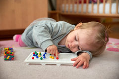 Toddler plays with pins Stock Photography
