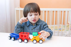 Toddler plays puffer Royalty Free Stock Photography