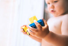 Toddler plays with toy blocks and constructors stock photography