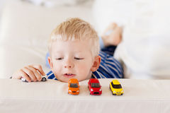 Toddler plays toy cars Royalty Free Stock Image