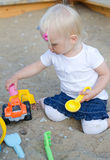 Toddler plays with toys Royalty Free Stock Images