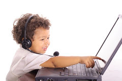 Toddler pointing a computer Royalty Free Stock Image