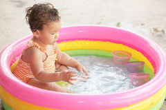 Toddler in a pool Royalty Free Stock Photos