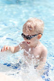 Toddler in a pool Royalty Free Stock Images