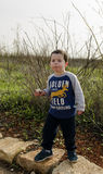 Toddler posing at nature eating Krembo Royalty Free Stock Photography