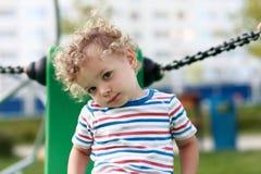 Toddler posing at playground Stock Images