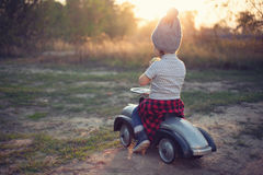 Toddler posing with toy car Stock Photography