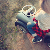 Toddler posing with toy car Stock Images