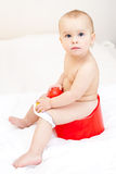 Toddler on a potty. Cute little baby girl sitting on red potty stock image