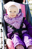 Toddler in pram. Toddler sitting in a pram on walk Royalty Free Stock Photo