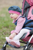 Toddler in pram Stock Images