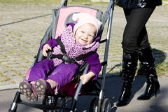 Toddler in pram Stock Image