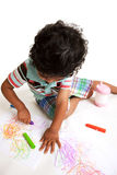 Toddler Producing Art Work with Crayons. On White Background stock photography
