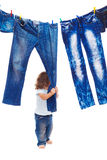 Toddler pulling denim clothes. Isolated royalty free stock photo