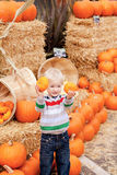 Toddler at the pumpkin patch Stock Images