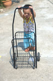 Toddler push a cart Stock Images