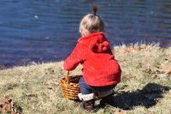 Toddler reaching into basket royalty free stock image