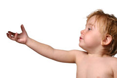 Toddler reaching for object Royalty Free Stock Photo