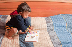 Toddler reading book Stock Photography