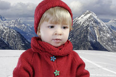 Toddler in red in the mountains Royalty Free Stock Images