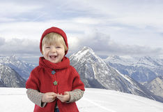 Toddler in red in the mountains Stock Images