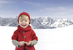 Toddler in red in the mountains Stock Photos