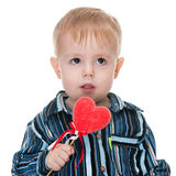 Toddler with a red valentine heart Stock Images