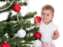 Toddler with red and white balls Royalty Free Stock Image