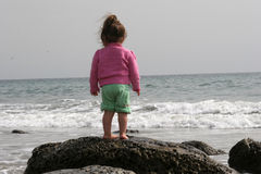 Toddler Reflections. Small Child looking Out to Sea stock image