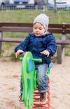 Toddler on a ride on spring Royalty Free Stock Images