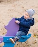 Toddler on a ride on spring Stock Photos