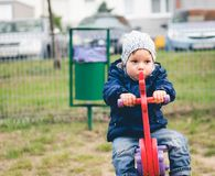 Toddler on a ride on spring Royalty Free Stock Photo
