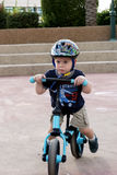 Toddler riding his balance bicycle Stock Photography