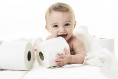 Toddler ripping up toilet paper in bathroom studio. A Toddler ripping up toilet paper in bathroom studio Stock Photos