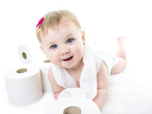 Toddler ripping up toilet paper in bathroom studio Royalty Free Stock Photography