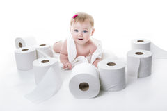 Toddler ripping up toilet paper in bathroom studio Stock Photos