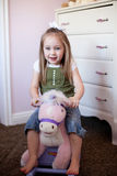 Toddler on a rocking horse Royalty Free Stock Photography