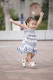 Toddler running around stock photo