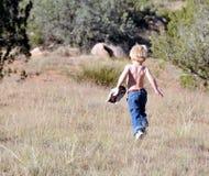 Toddler running outdoors Stock Image