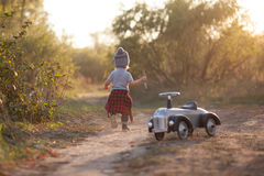 Toddler running during stroll Royalty Free Stock Images