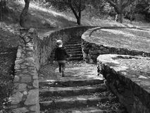 Toddler running up steps Stock Photography