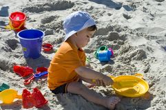 Toddler on sand. Toddler with toys on sand Royalty Free Stock Photo