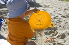 Toddler on sand. Toddler with toys on sand Royalty Free Stock Photos