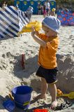 Toddler on sand. Toddler plays on sand Stock Photography