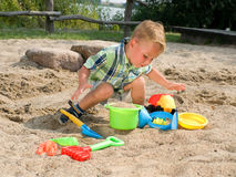 Toddler with sand toys Stock Images