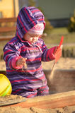 Toddler in the sandbox. Little baby in the sandbox Stock Images