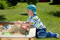 Toddler in the sandbox Stock Photos