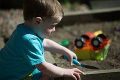 Toddler on sandbox stock images