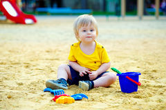 Toddler in the sandpit Stock Photography